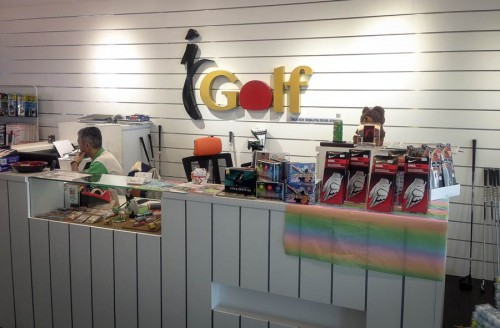 J-Golf's counter with the logo as a backdrop
